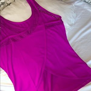 Fabletics tank top with open lower back design